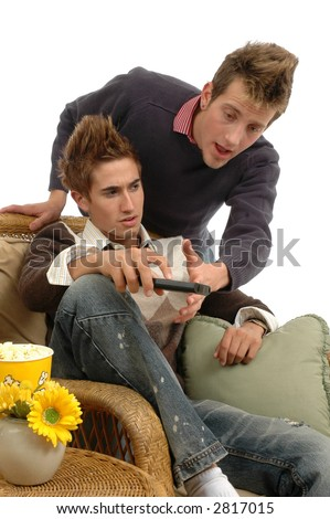 Two friends fighting over the remote control channel changer