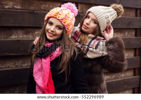 Two friends girl are wearing warm winter clothes