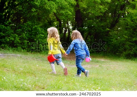 two friends girls walking hand in hand - stock photo