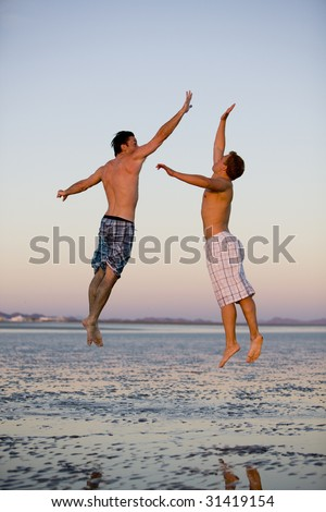 Two Friends Giving Each Other a High Five - stock photo