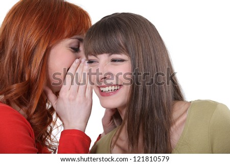 Two friends gossiping. - stock photo
