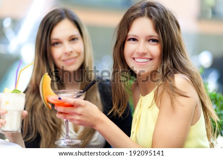 Two friends having a cocktail outdoor  - stock photo