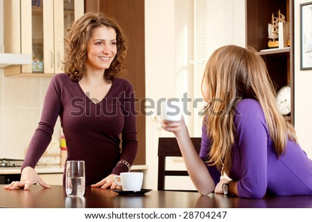 two friends having coffee and chatting - stock photo