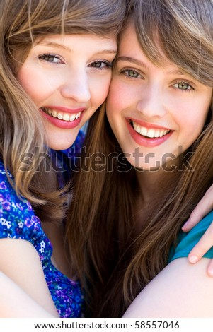 Two friends hugging - stock photo