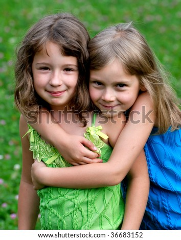 Two friends in hugs - stock photo