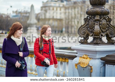 Two friends in Paris on the Pont Alexandre III - stock photo