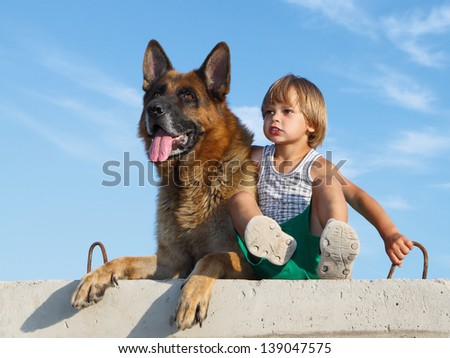 Two friends:kid and his faithful dog. - stock photo