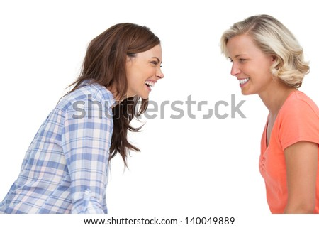 Two friends laughing together on white background - stock photo