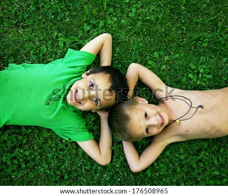 two friends laying in the grass