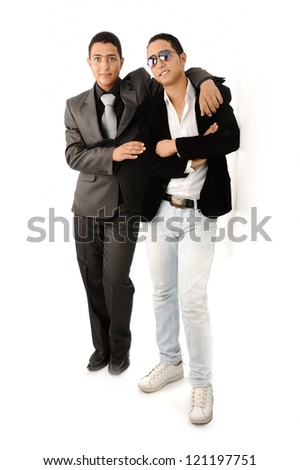 Two friends leaning against the wall - stock photo
