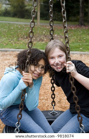 two friends of different ethnicities at the park - stock photo