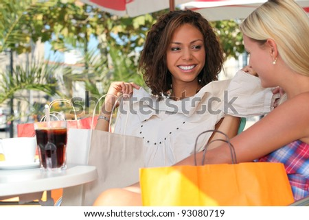 Two friends on a shopping trip - stock photo