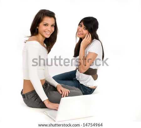 Two friends on the computer and phone together - stock photo