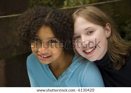 two friends...one is black and the other is white - stock photo