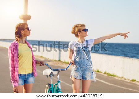 Two friends out for a bike ride at the seaside