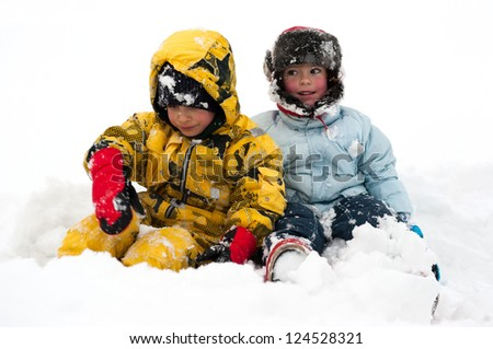 Two friends playing in the snow. - stock photo