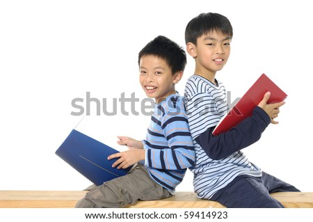 Two friends reading a book-back to back - stock photo