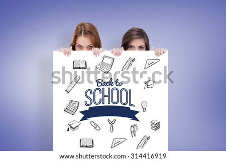 Two friends secretly hiding behind a blank poster against purple vignette - stock photo