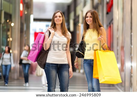 Two friends shopping together - stock photo