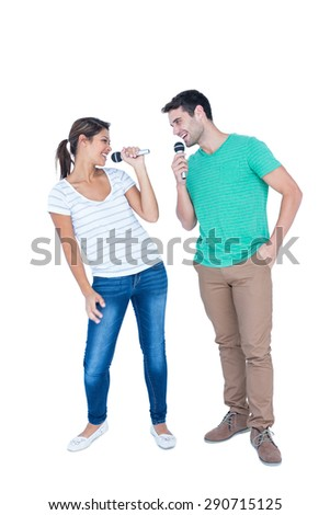 Two friends singing on micro on white bqckground