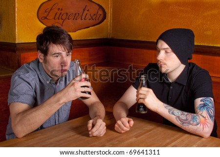 Two friends sitting in a pub and drinking