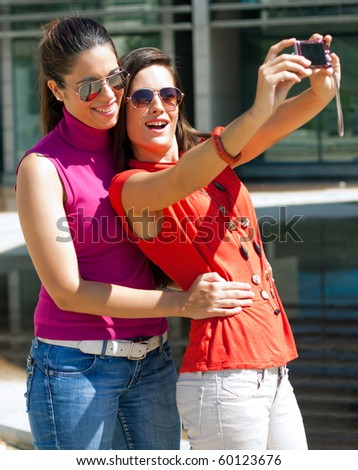two friends taking a picture - stock photo