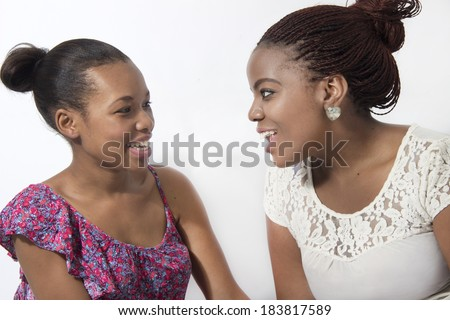 Two friends talking and laughing , love the friendship