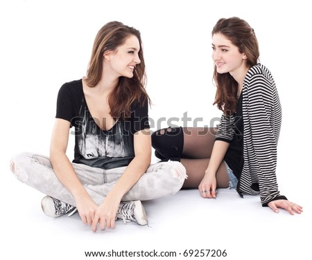 Two friends talking to each other. The image is isolated on a white background. - stock photo