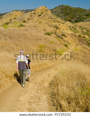 Two friends travel together to mountains on the Long Canyon trail at Simi Valley, California, US - stock photo