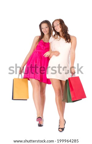 Two friends with shopping on a white background - stock photo