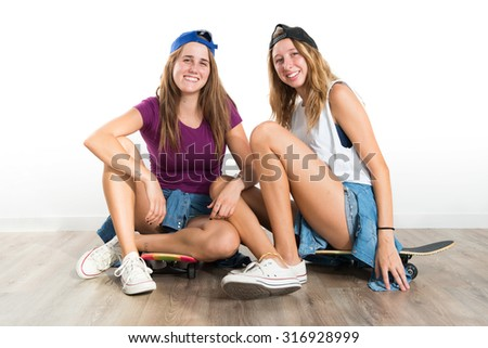 Two friends with their skateboards
