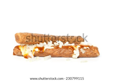 Two frikandellen speciaal, a Dutch fast food snack, with mayonnaise, curry sauce and chopped onions - stock photo