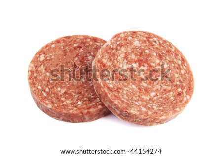 Two frozen hamburger patties isolated on white background - stock photo