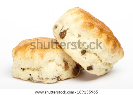 Two fruit scones on a white background