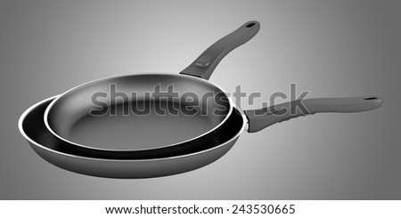 two fryer pans isolated on gray background - stock photo