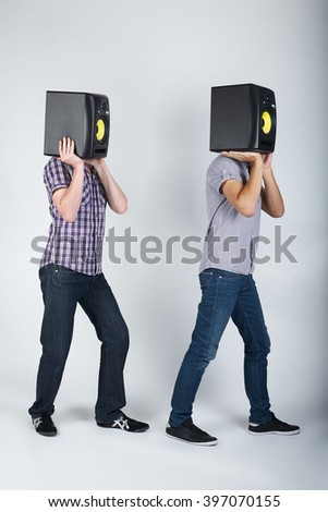 two funny boys with speakers - stock photo
