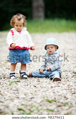 two funny children in park - stock photo