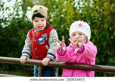 two funny children playing in the park - stock photo