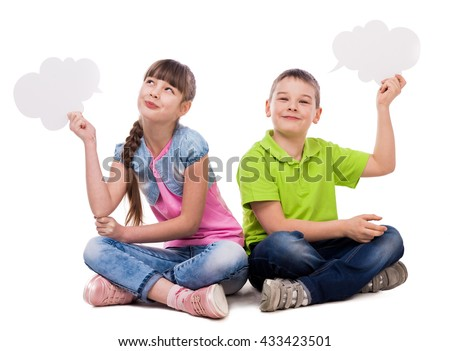 two funny children sitting on the floor with paper clouds in hands laughing isolated on white background - stock photo