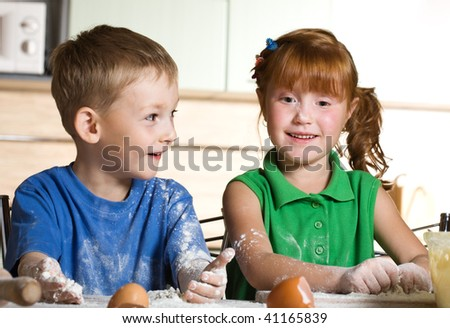 Two funny cooks - stock photo