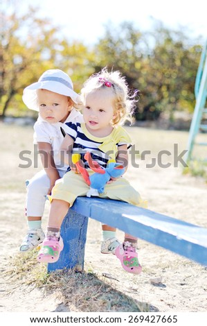 two funny friends playing on the bench - stock photo
