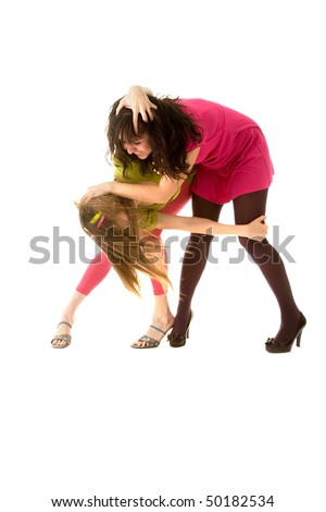 Two funny girls fighting and laughing - stock photo