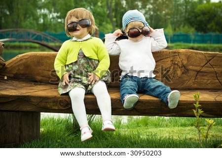 Two funny girls in sunglasses - stock photo