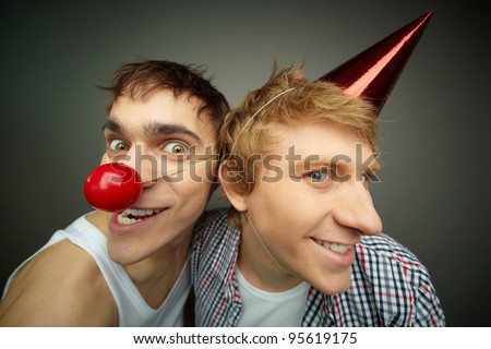 Two funny guys making faces at camera celebrating fool�s day - stock photo