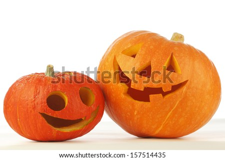 Two funny Halloween pumpkins on white background