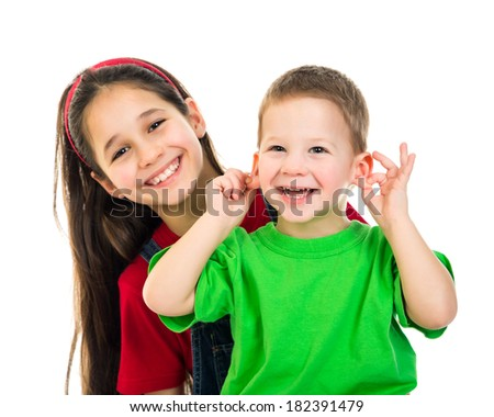 Two funny happy kids together, isolated on white - stock photo