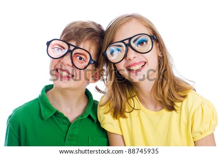 Two funny kids with weird novelty glasses on. - stock photo
