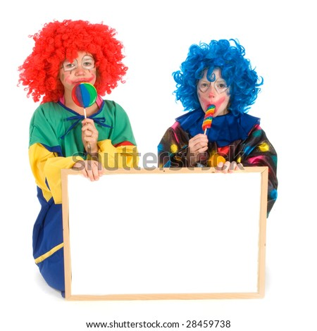Two funny little clowns with board for text - stock photo