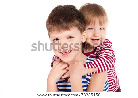 two funny siblings portraits isolated on white - stock photo