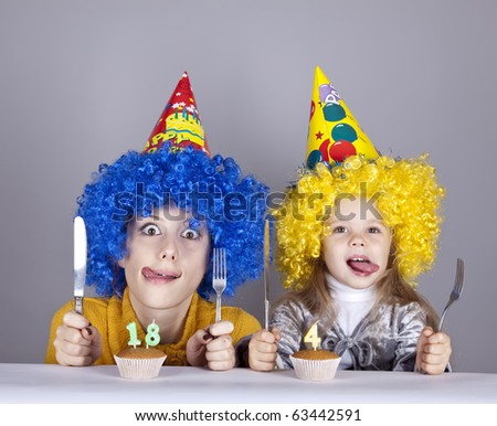 Two funny sisters four and eighteen years old in studio. - stock photo